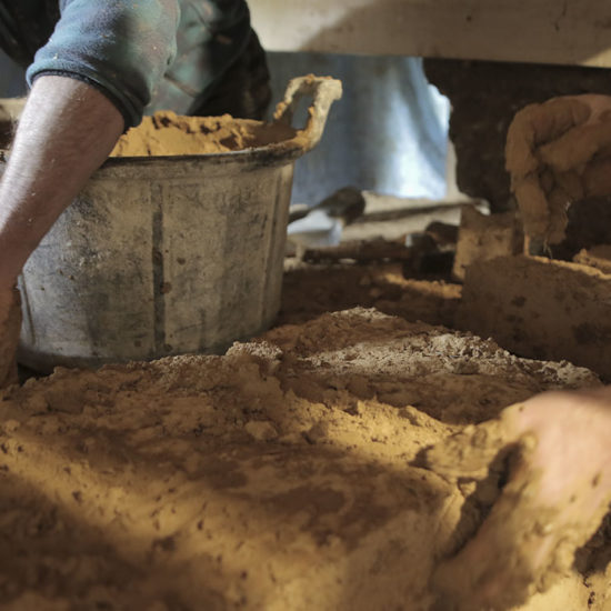 Reconstruction en adobe et mortier de terre